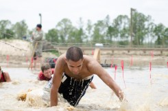crawling-under-barb-wire-mud-run