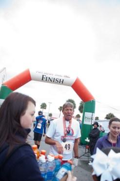 runner crossing finish line