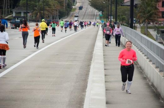 runners racing over bridge