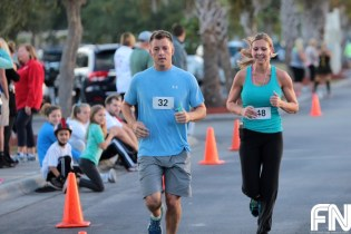 people in blue shirts running
