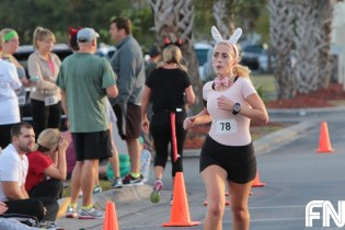 female in bunny costume running