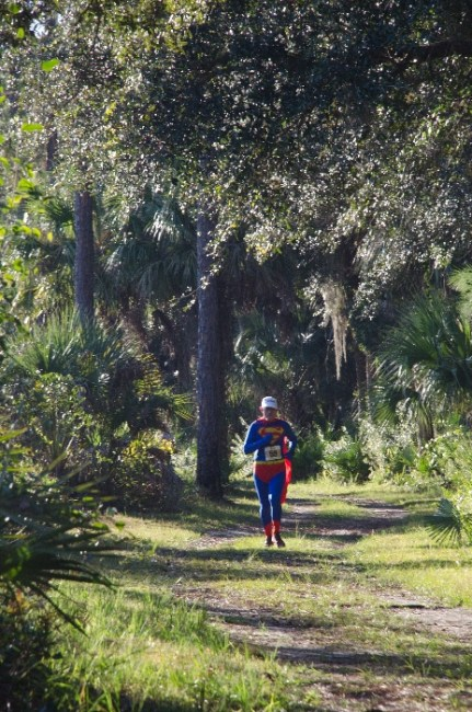 Man running on trails in costume