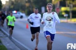 White male white shirt running
