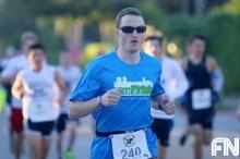 man in blue shirt running
