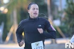 man black shirt running
