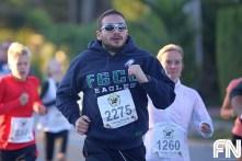 man in fgcu sweatshirt running