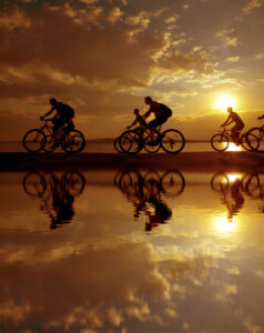 Image of sporty company six friends on bicycles outdoors against