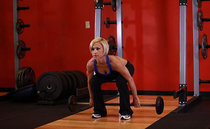 Woman Working Out Barbell Hack Squat