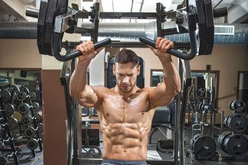 Man Working Out Hammer Strength Chest Press