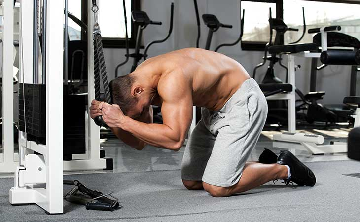 Man Using A Rope Crunch Machine For Abs