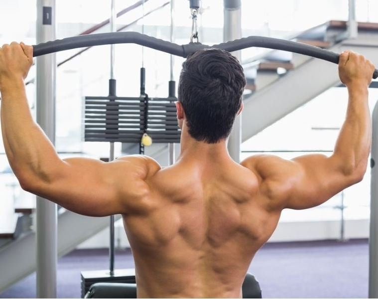 Man doing wide grip pull downs