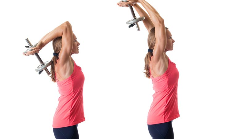 Woman Working Out Standing Dumbbell Tricep Extension