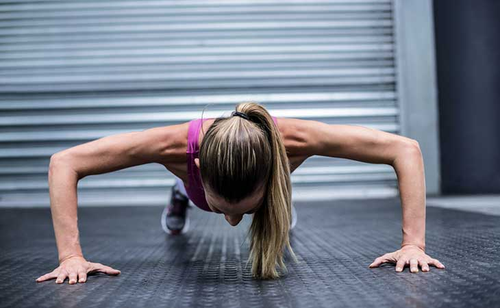 Woman Working Out Chest Wide Grip Push Up