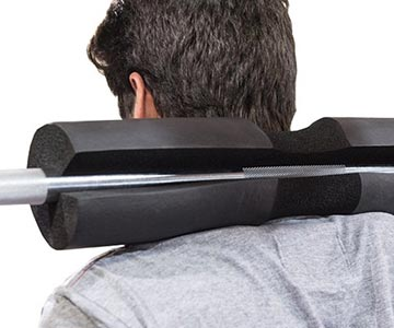 Man Showing How To Use Barbell Pad