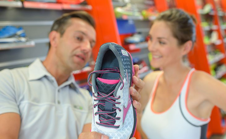 Man and Woman Choosing Weightlifting Shoes