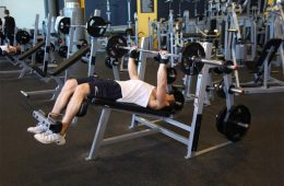 Fitness Man Using A Decline Bench Press For Chest