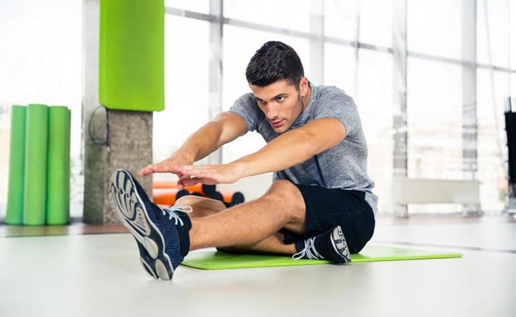 Fit Man Stretching After Working Out