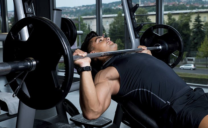 Man Working Out Using Weight Bench