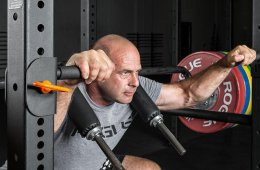 Man Using A Safety Squat Bar For Fitness