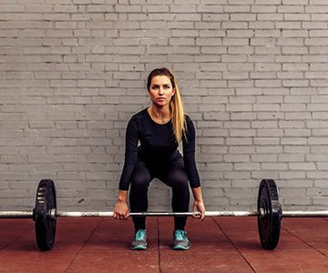 Woman Performing Deadlifts For Fitness