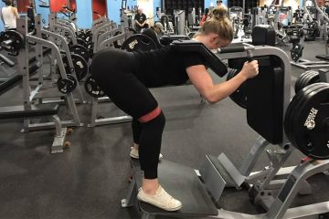 Woman Doing The Reverse Hack Squat