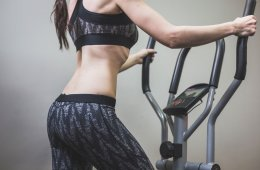 Woman Using Glute Machine For Fitness