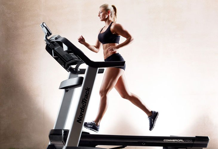 Woman Using ordicTrack Commercial 1750 Treadmill