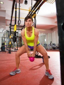woman swinging a kettlebell