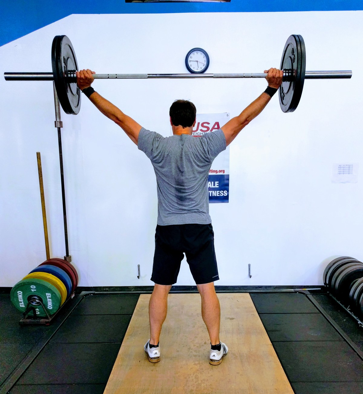 Lift lighter to add muscle, Overhead barbell lift