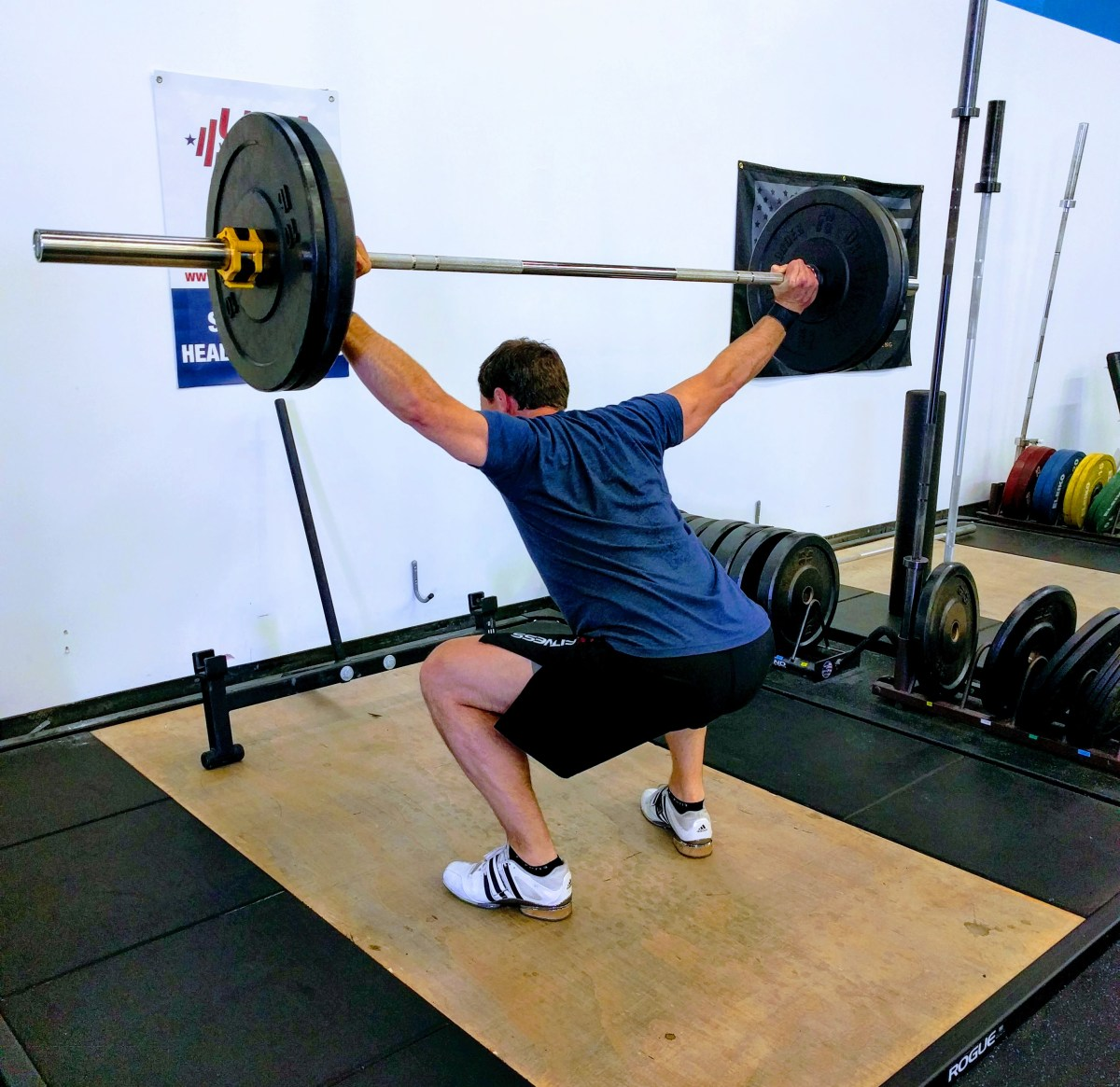 Overhead Squat, mix up your weights and reps for greater strength gains