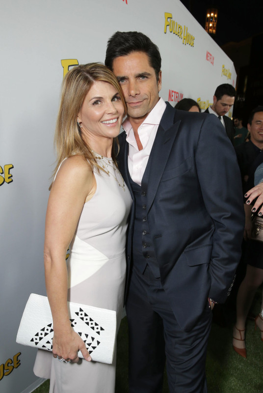 "Lori Loughlin and John Stamos seen at Netflix Premiere of ""Fuller House"" at The Grove - Pacific Theatres on Tuesday, February 16, 2016, in Los Angeles, CA. (Photo by Eric Charbonneau/Invision for Netflix/AP Images)"