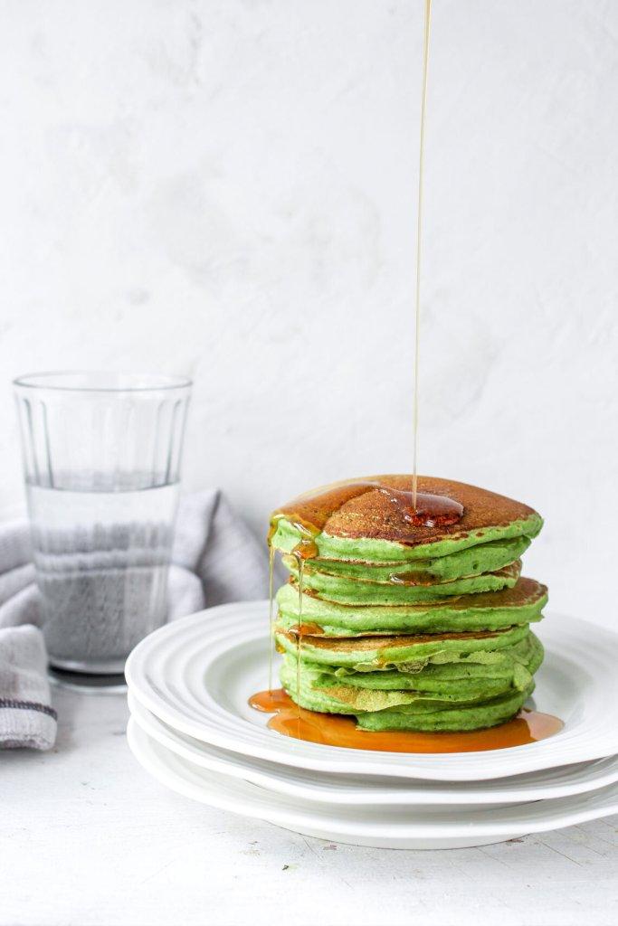 Green vegan pancakes on a plate