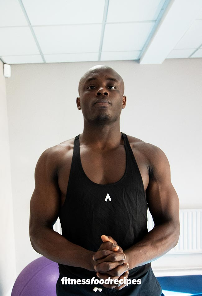 Ola Ipaye doing a Body Building Pose in the Gym