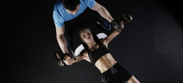 a person working out with a trainer