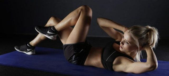 a personal trainer at home training
