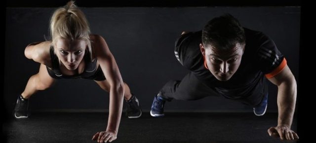 enjoy th eservices of personal trainers - a woman and a man working out