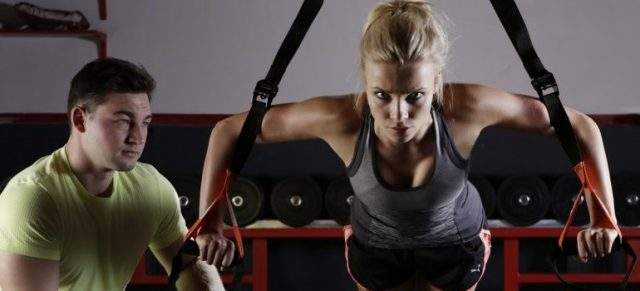 woman workout with personal trainer