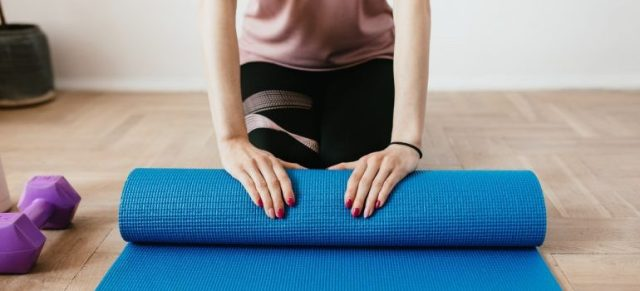 Woman folding a sportmat
