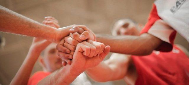 Team players raising hands