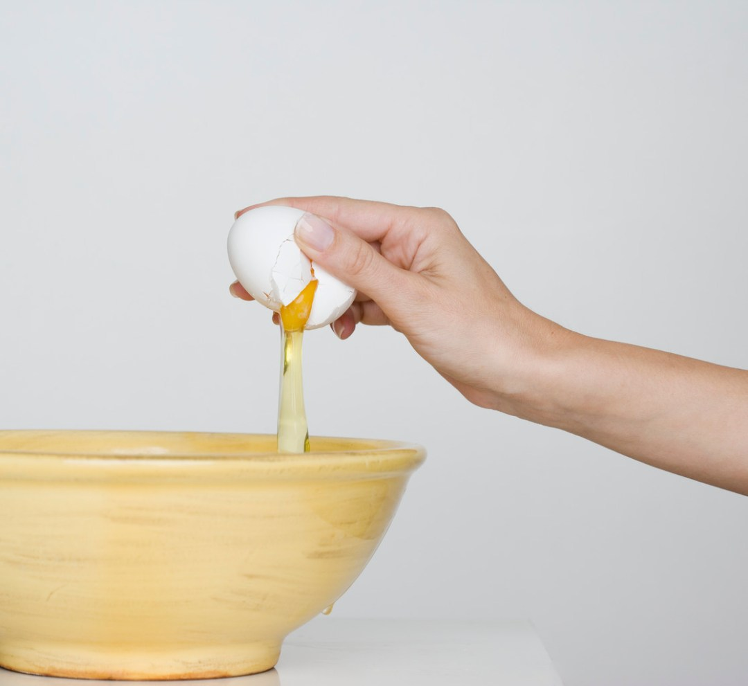 Egg Cracked Open Into Mixing Bowl