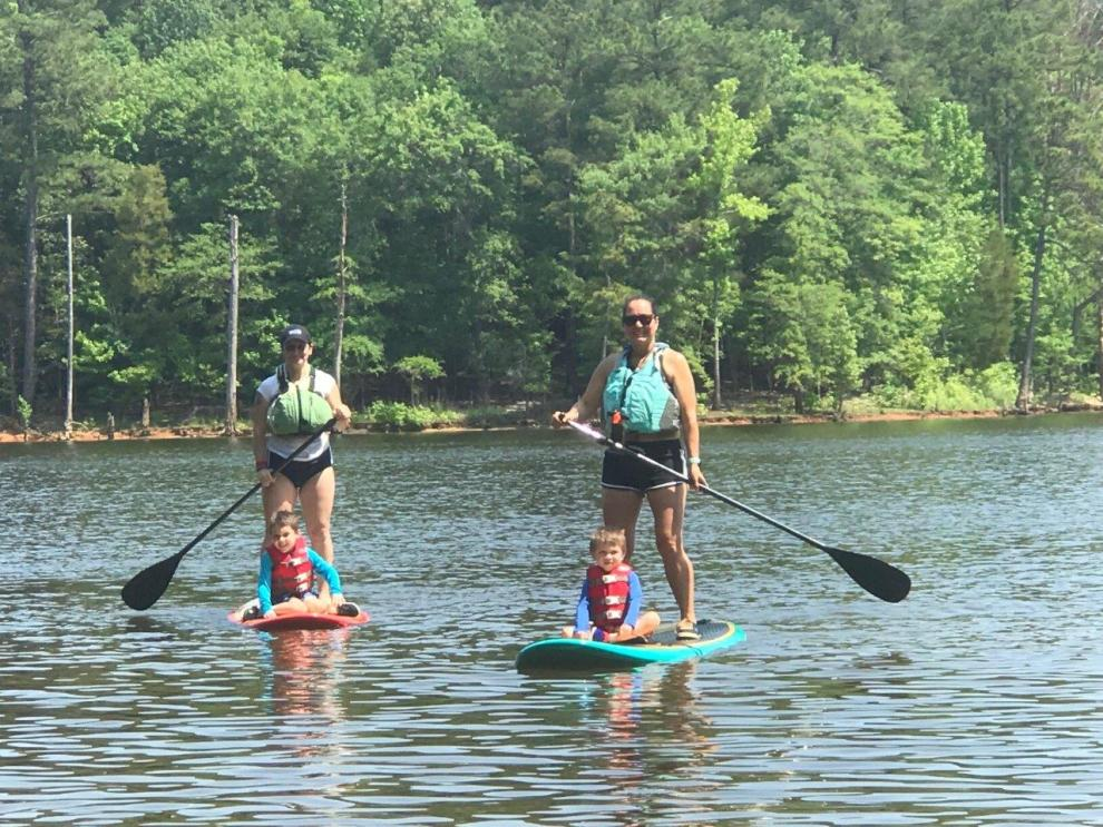 Stand up paddle boarding with a friend and my boys riding in front.
