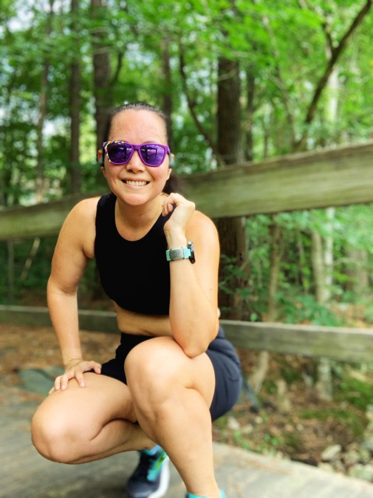 Crouching mid-run and showing off my RoadiD Sidekick attached to my Garmin watchband.