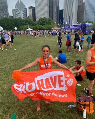 BibRave Co-Founder Jessica Murphy holding a BibRave banner at the RnR Chicago post-race celebration
