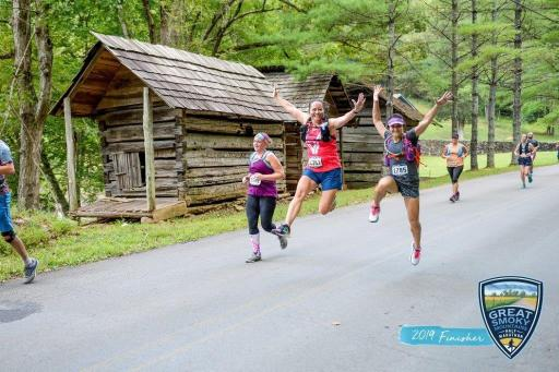 Jumping in the air with a friend during the Great Smoky Mountain half marathon.
