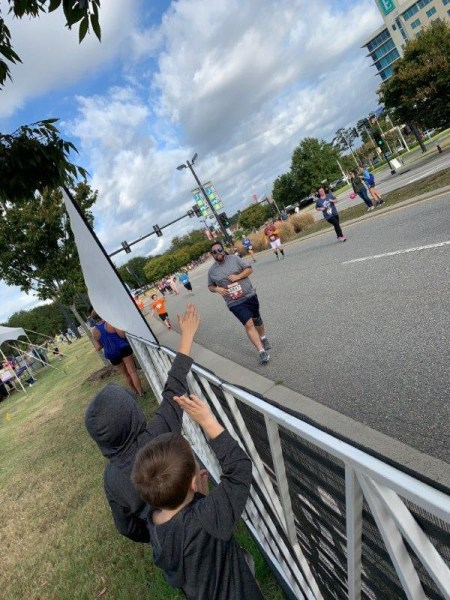 The boys cheering James on from the side as he approached the 5k finish line.