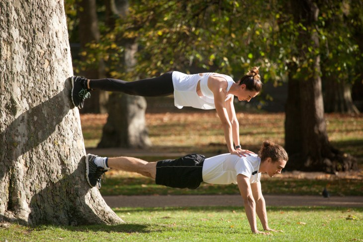 How to stay fit while traveling - train with a workout buddy in the park