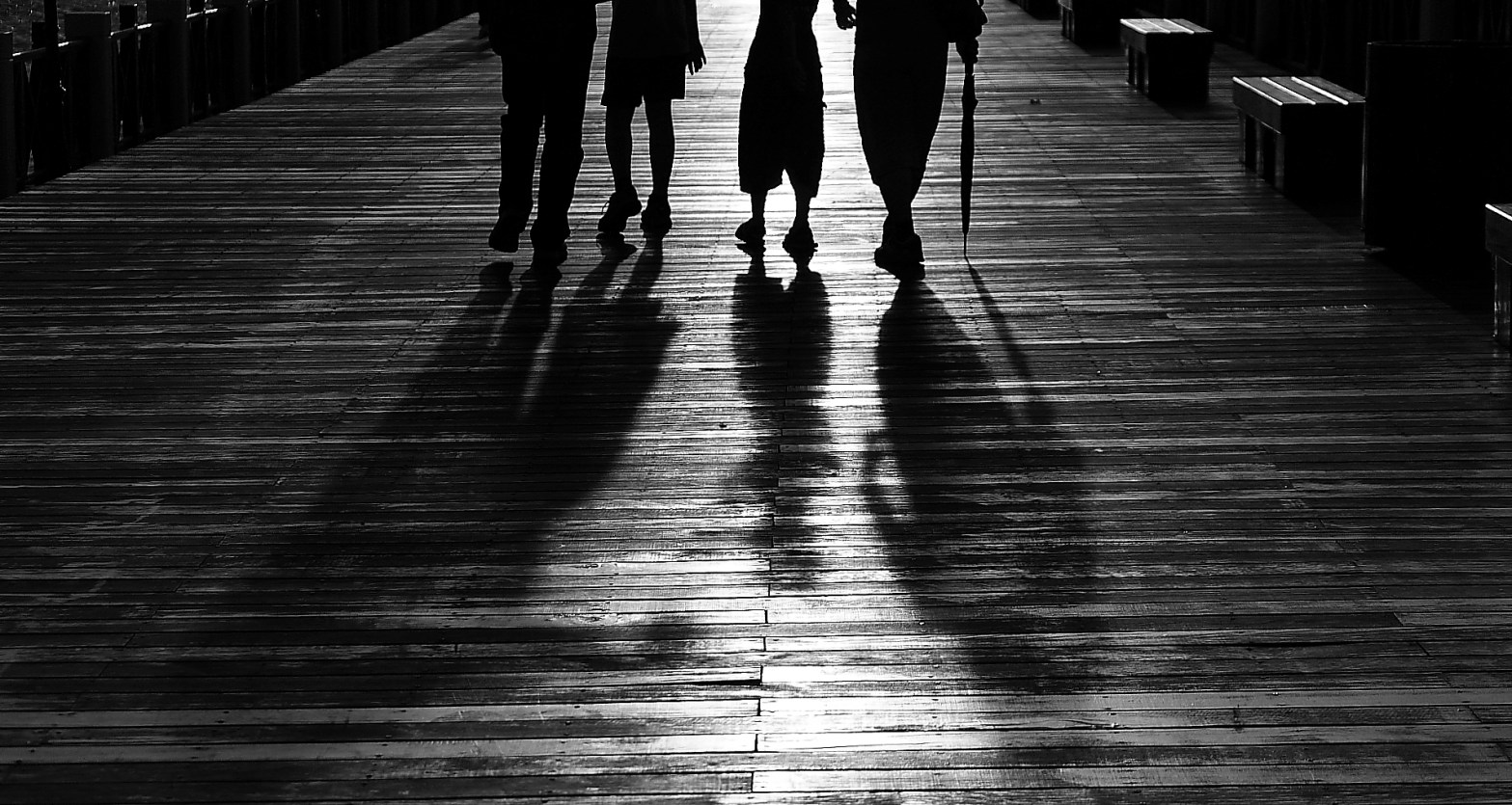 silhouette of 4 people walking