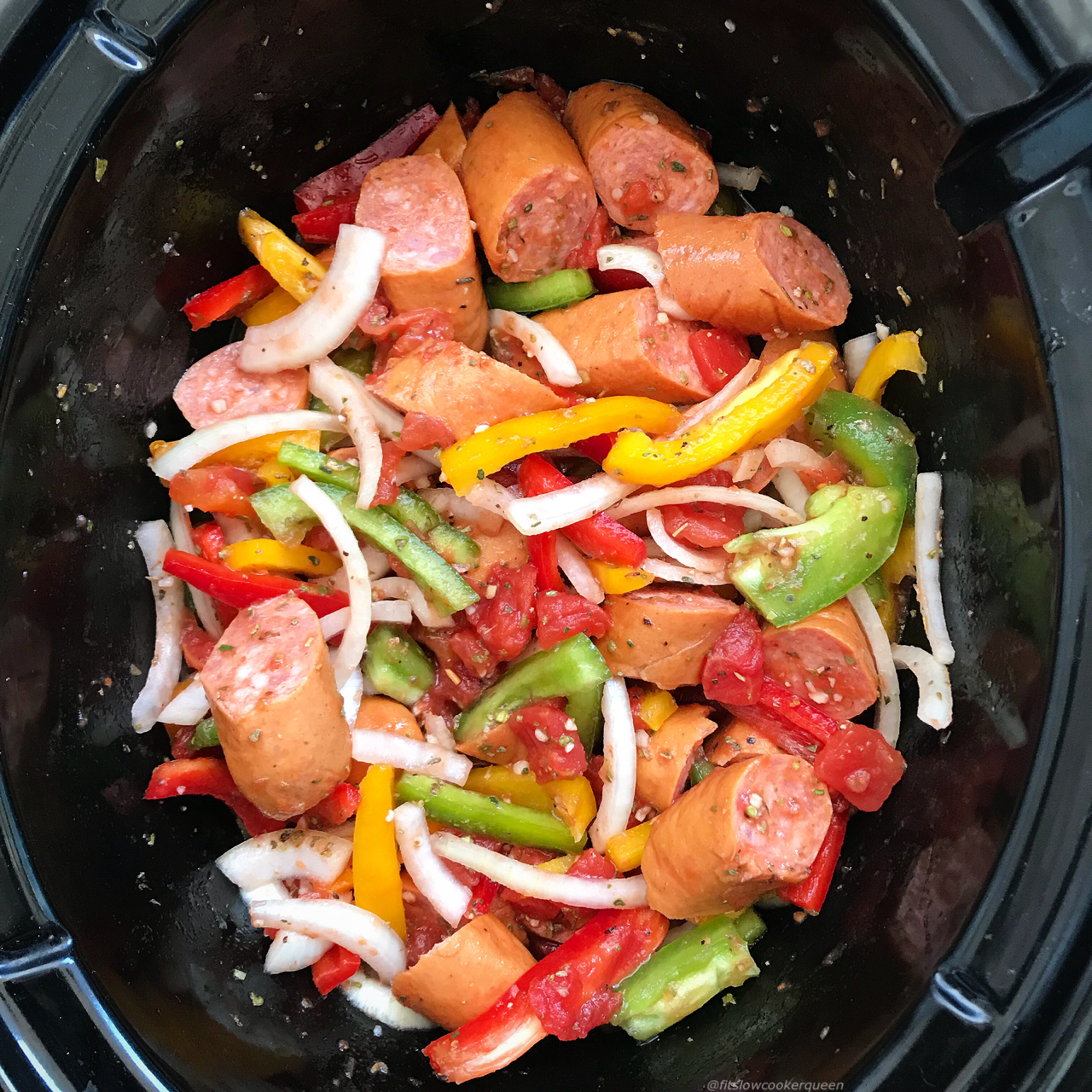 Grab your favorite sausages and slow cook them with bell peppers, onions, and tomatoes in this aromatic and flavorful paleo, whole30, and low-carb recipe.