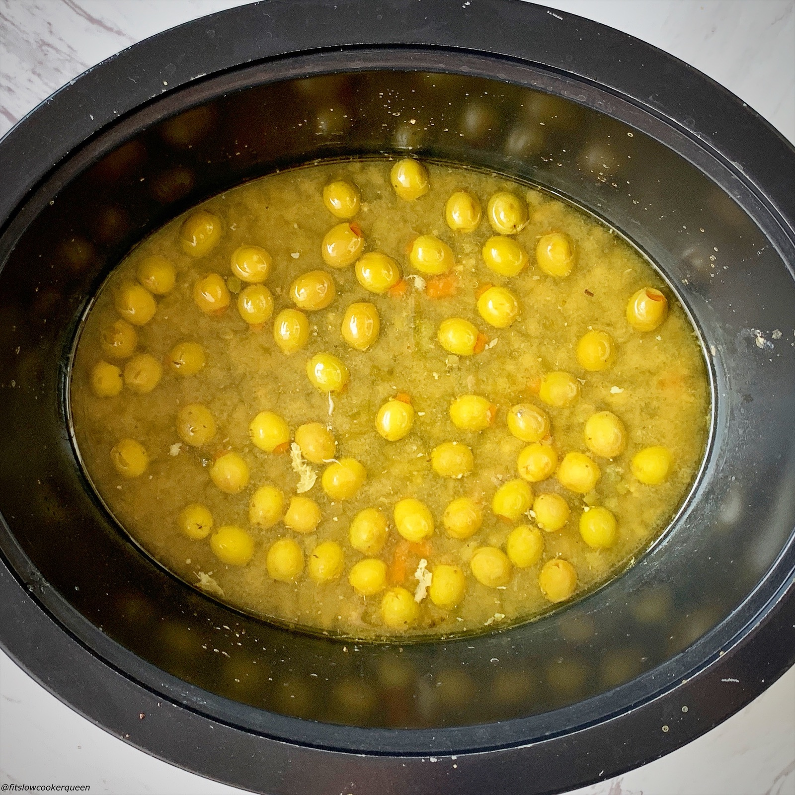 olives, capers and sauce in the slow cooker with chicken removed