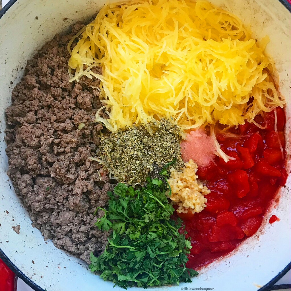 This healthy and simple whole 30 compliant one-pot meal consists of spaghetti squash, ground meat, diced tomatoes and fresh herbs.